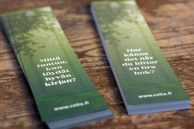 """Kirjanmerkkejä, joissa kuva metsästä ja teksti """"Mitlä tuntuu, kun löytää hyvän kirjan?"""""""